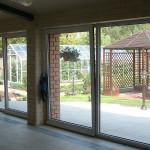 Виды раздвижных стеклянных дверей