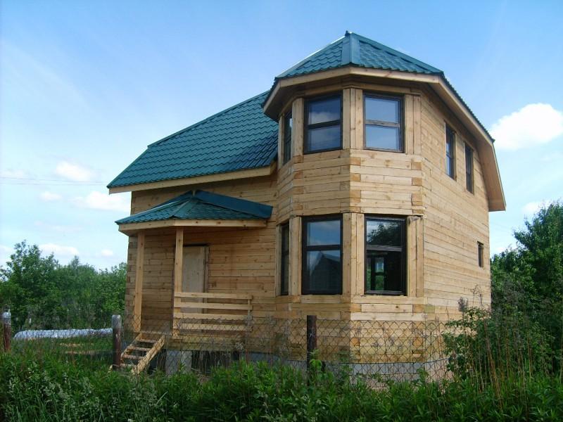 дом с бруса с эркером