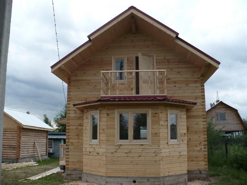 дома из бруса проекты фото с эркером