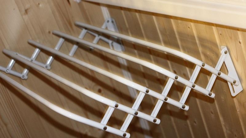 Сушилка для белья на балкон: виды и особенности